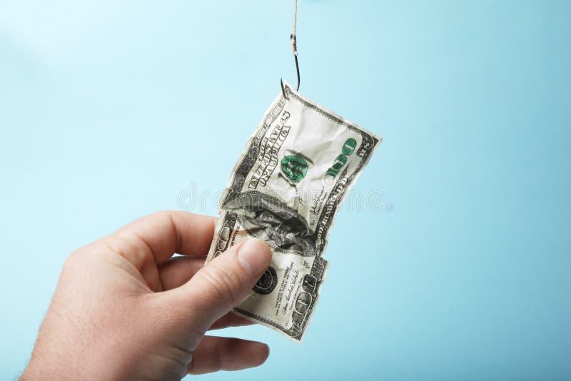Geldzwendel, lokmiddel van honderd dollars stock afbeeldingen