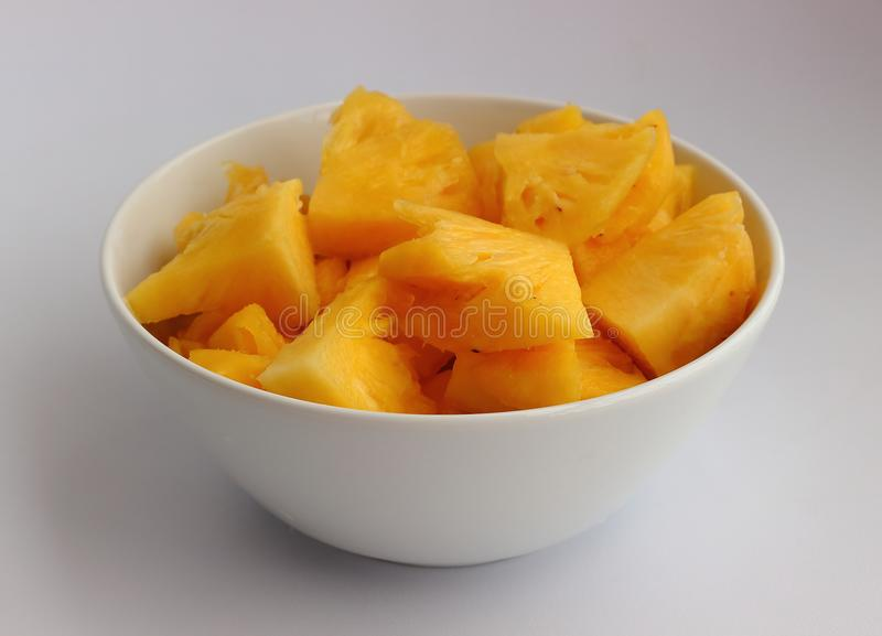 Gele ananas op lichte achtergrond royalty-vrije stock foto
