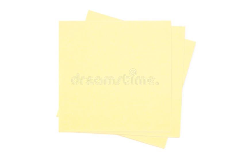 Gele blocnote drie op witte achtergrond stock afbeeldingen