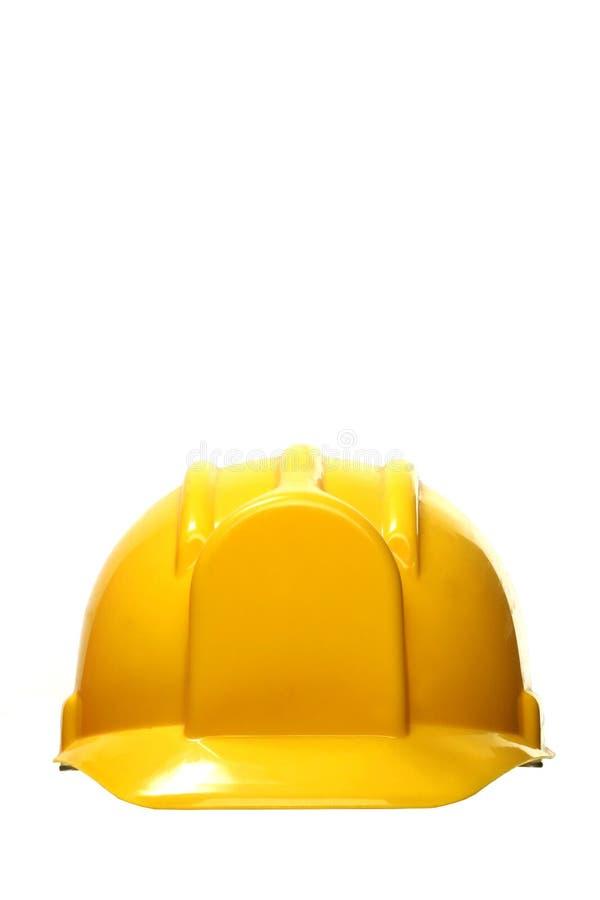 Gele bouwvakker op wit stock fotografie