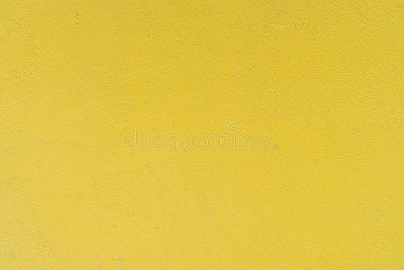 Gele concrete het cementmuur van de grungetextuur stock afbeelding
