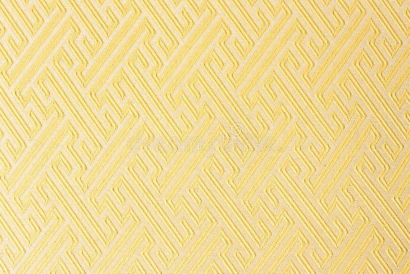 Gele de stoffen textieltextuur van de close-up stock afbeeldingen