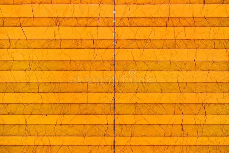 Gele document gordijnschaduwen royalty-vrije stock foto's