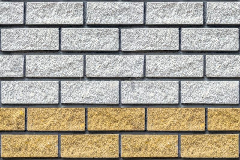 Gele en grijze baksteenachtergrond royalty-vrije stock afbeeldingen