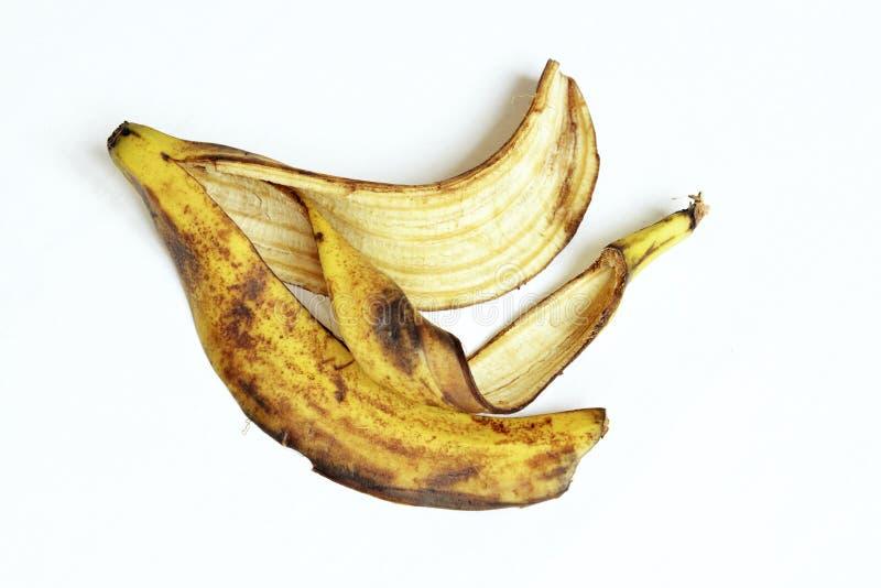 Gele en zwarte rijpe bananeschil stock foto's