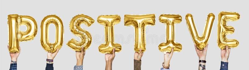 Gele gouden alfabetballons die het woordpositief vormen royalty-vrije stock afbeeldingen