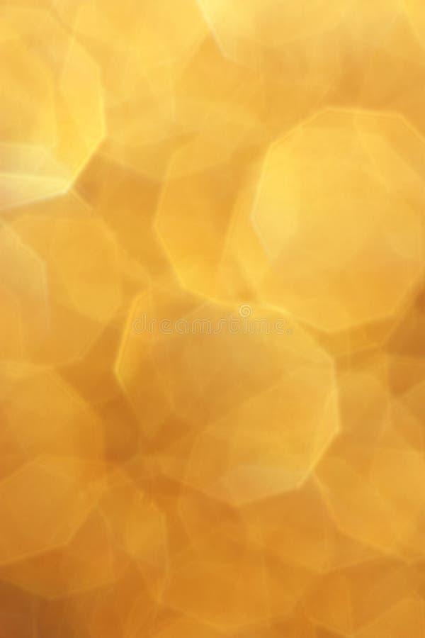 Gele Gouden Onduidelijk beeldachtergrond - de Foto's van de Kerstmisvoorraad royalty-vrije stock afbeelding