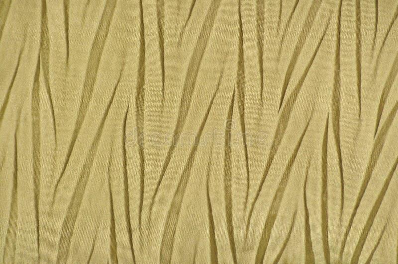 Gele Gouden Verfrommelde Synthetische textiel, Gevouwen Polyester stock foto's