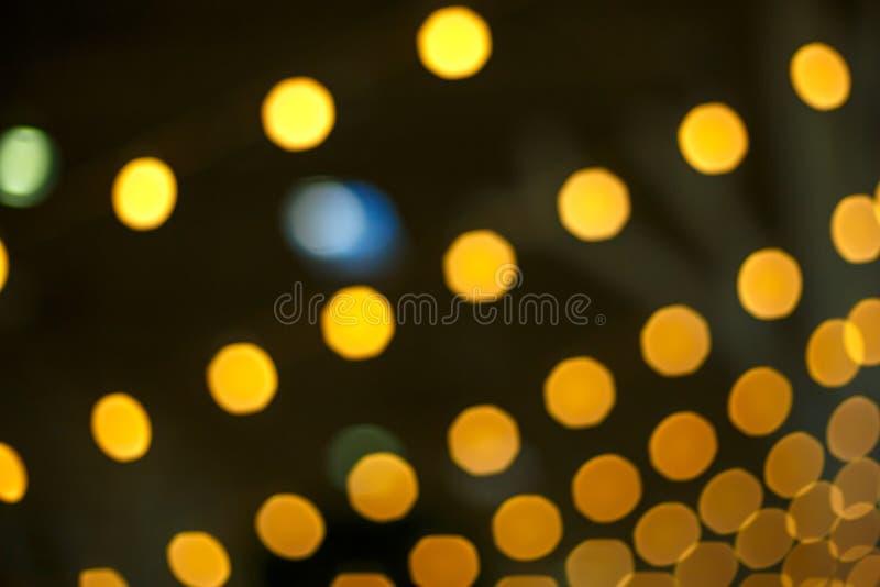 Gele heldere vage lichten, bokeh textuur royalty-vrije stock afbeelding