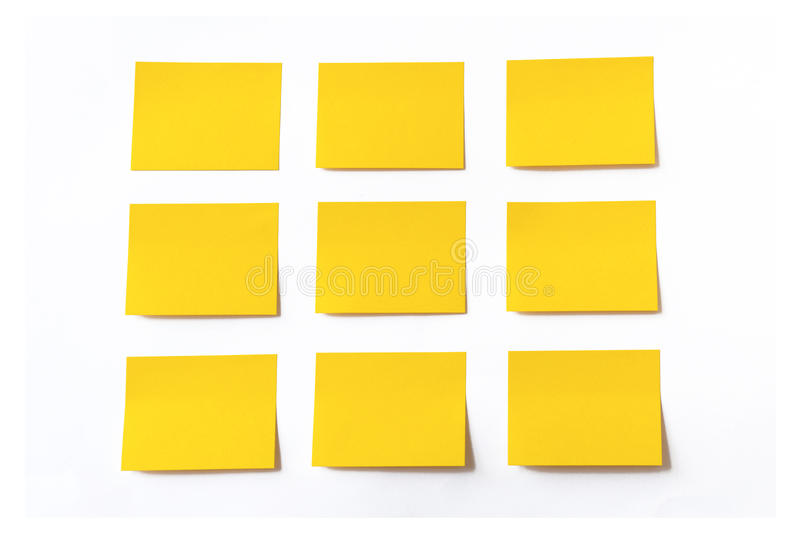 Gele kleverige nota's stock foto's