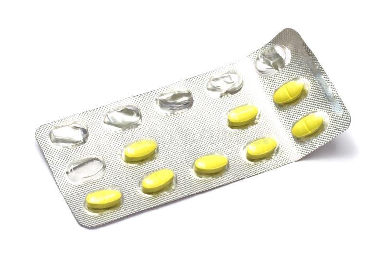 Gele pillen stock afbeeldingen