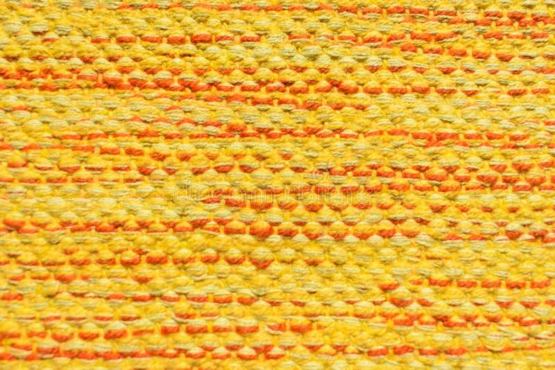 Gele stoffentextuur voor achtergrond stock afbeeldingen