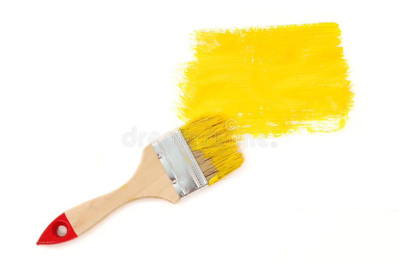 Gele verf met borstel stock afbeelding
