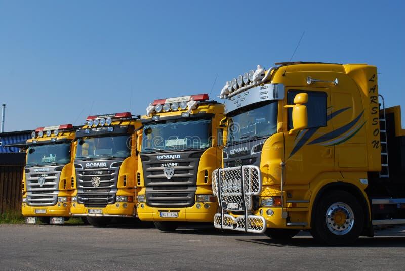Gele Vrachtwagens stock fotografie