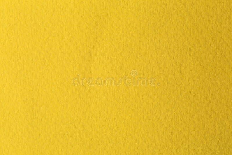 Gele waterverfdocument textuur voor achtergrond royalty-vrije stock foto