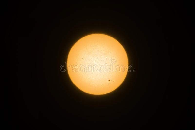Gele zon met zonnevlekken royalty-vrije stock foto