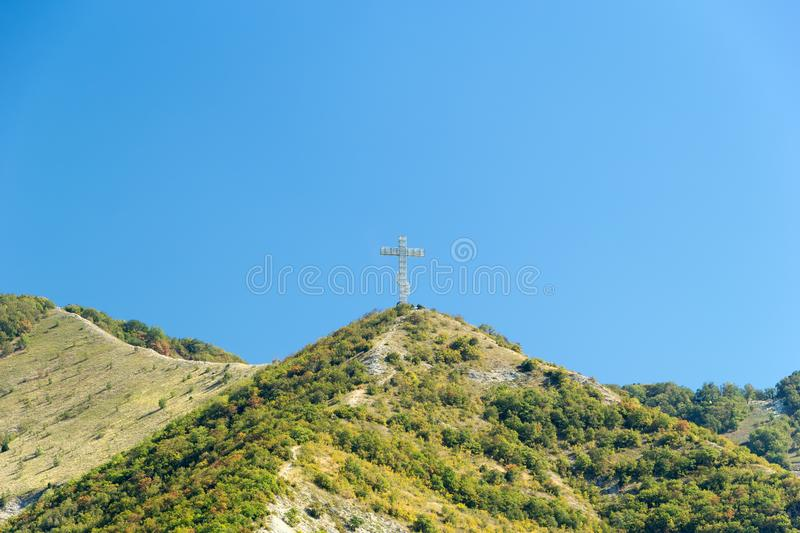 Gelendzhik, Krasnodar region, Russia, September 10. Orthodox worship cross on the hill of Caucasian mountains with stock image