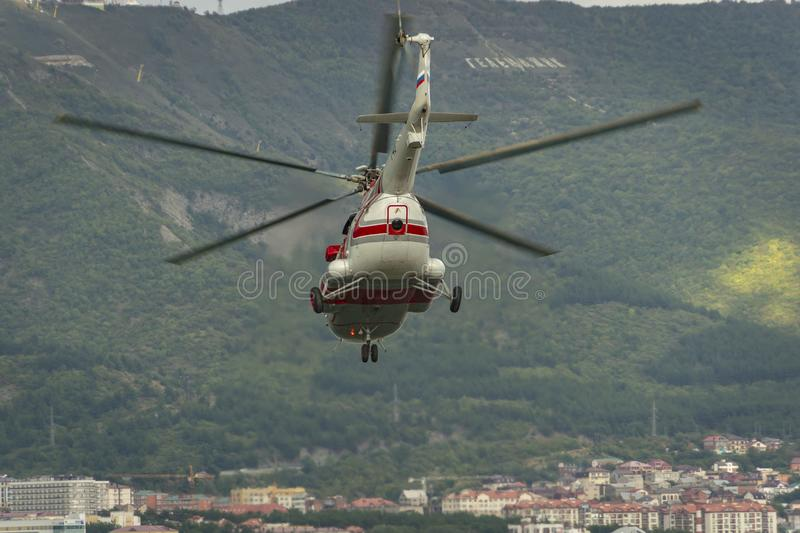 Russian helicopter Mi-8AMT in flight over the city stock images