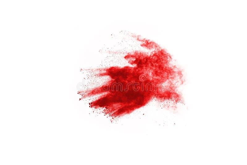 Gelez le mouvement de la poudre rouge éclatant, d'isolement sur le fond blanc photos stock