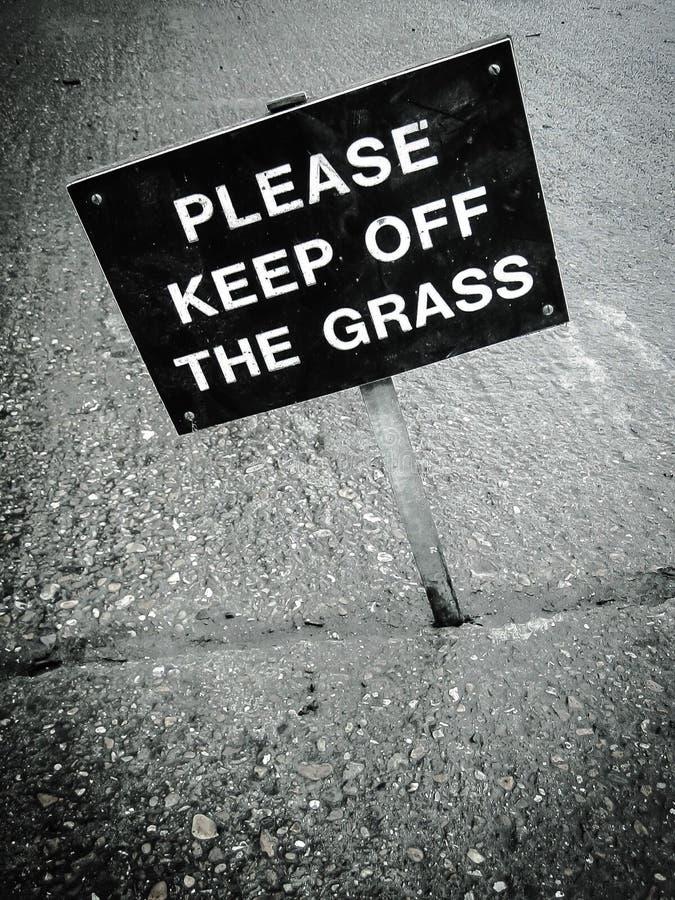 Gelieve te houden het grasteken op een afstand stock afbeeldingen