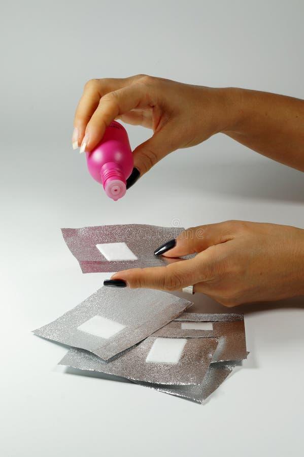 Gelifiqúese las hojas del removedor del esmalte de uñas del removedor y del gel del esmalte de uñas para hy imagen de archivo