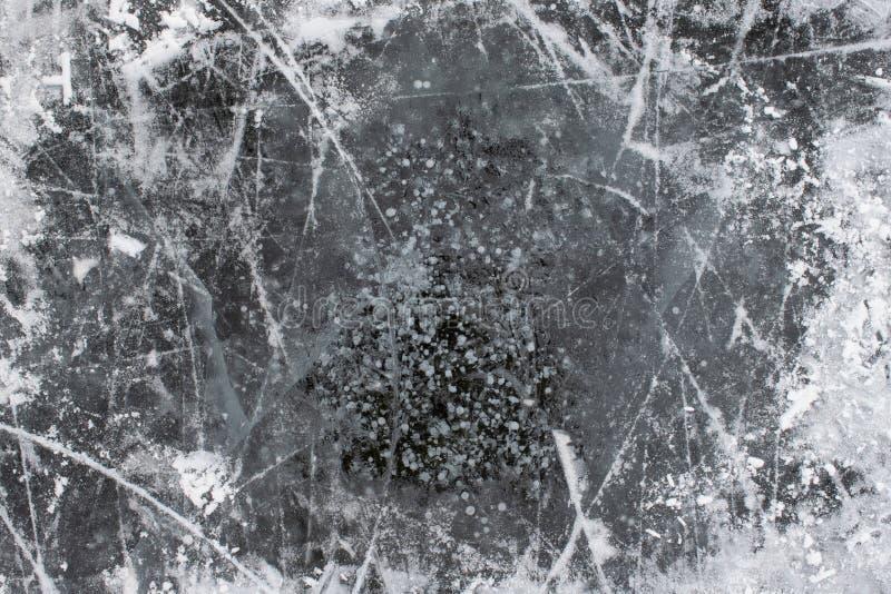 Gelo com fundo da textura da neve e dos riscos imagem de stock royalty free