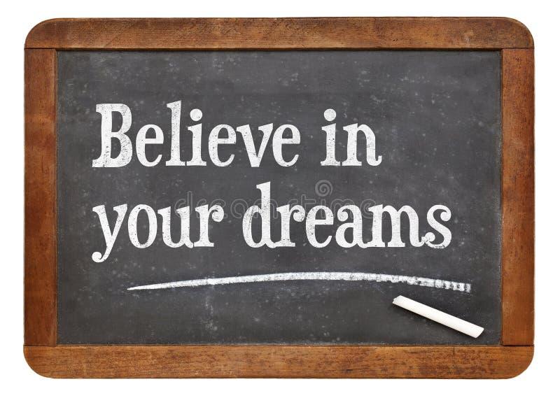 Geloof in uw dromen op bord stock foto's