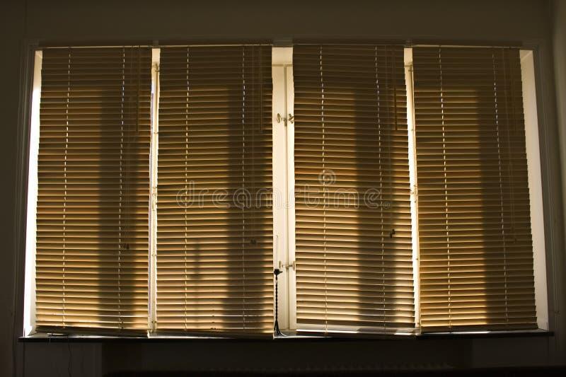 Gelosia di legno del sole immagine stock
