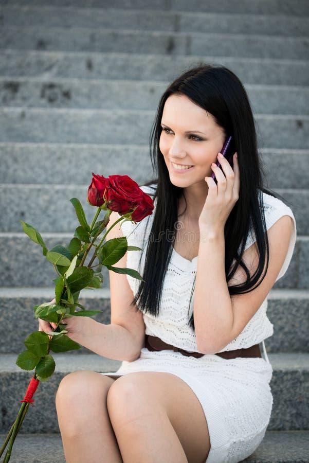 Geluk - vrouw met rozen royalty-vrije stock foto