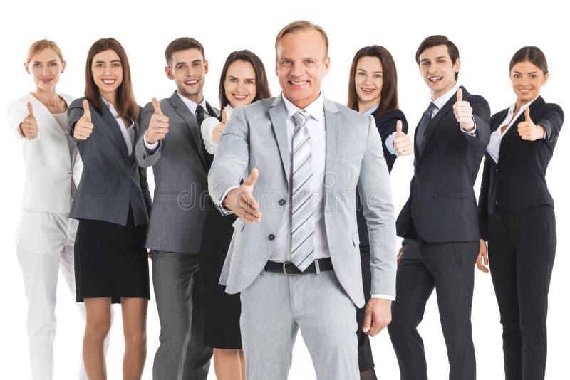 Gelukkig commercieel team met omhoog duimen stock afbeelding