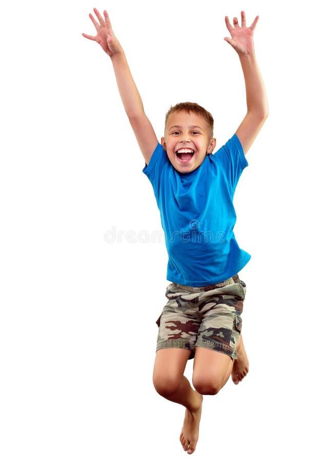 Gelukkig en kind die uitoefenen springen stock afbeeldingen