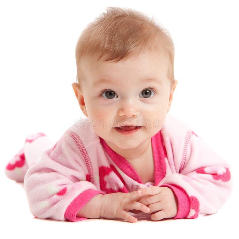 Gelukkig geïsoleerd, babymeisje in roze stock afbeeldingen
