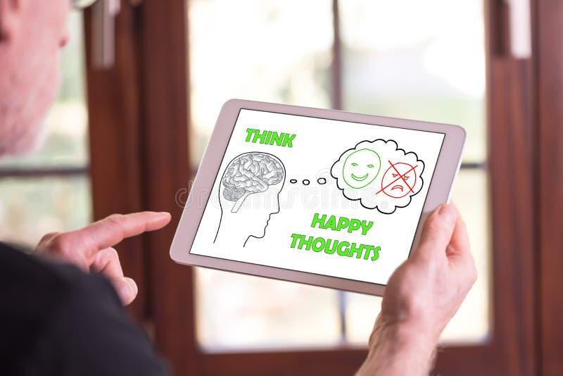 Gelukkig gedachtenconcept op een tablet stock afbeeldingen