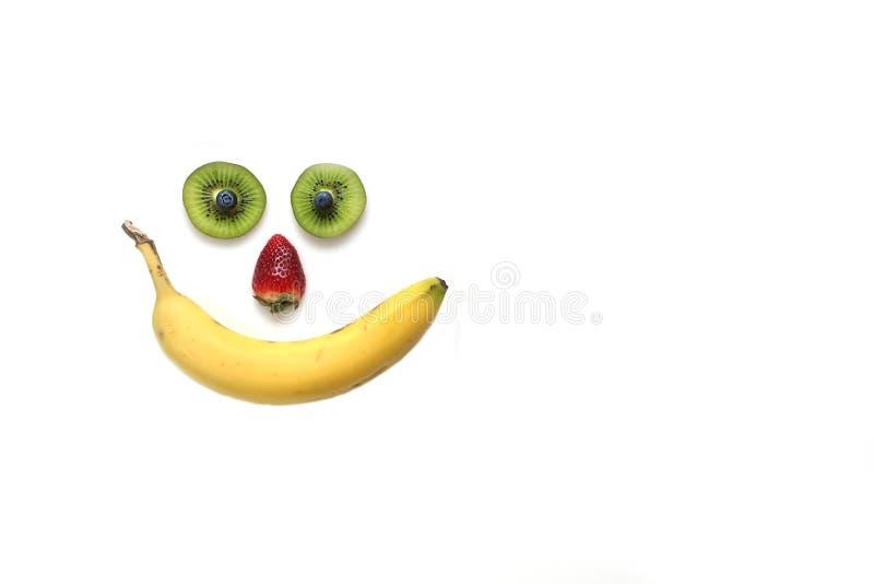 Gelukkig gezicht dat met vruchten wordt gemaakt stock foto's