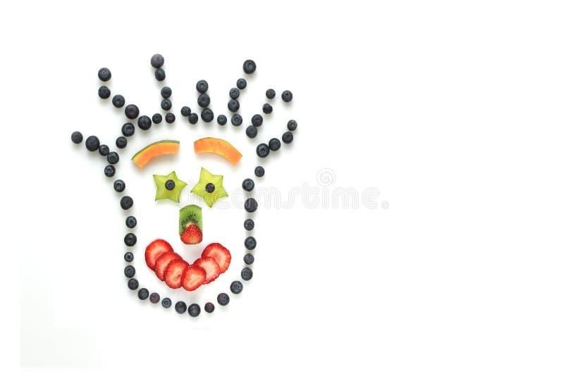 Gelukkig gezicht met vruchten stock afbeelding