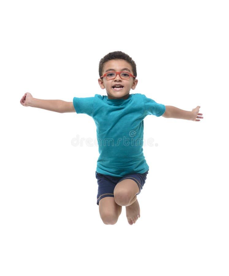 Gelukkig Kind die in de Lucht springen royalty-vrije stock foto's