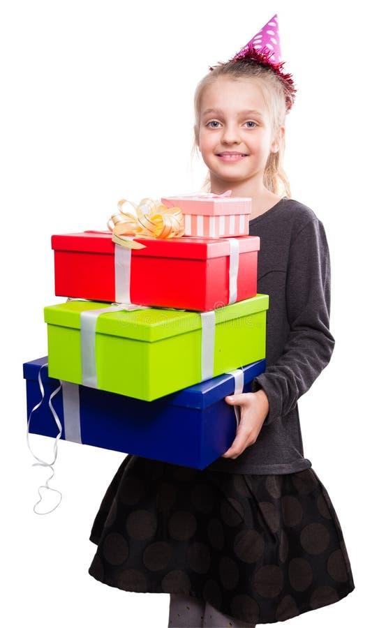 Gelukkig kind met heel wat giftdozen in handen op geïsoleerde achtergrond royalty-vrije stock fotografie