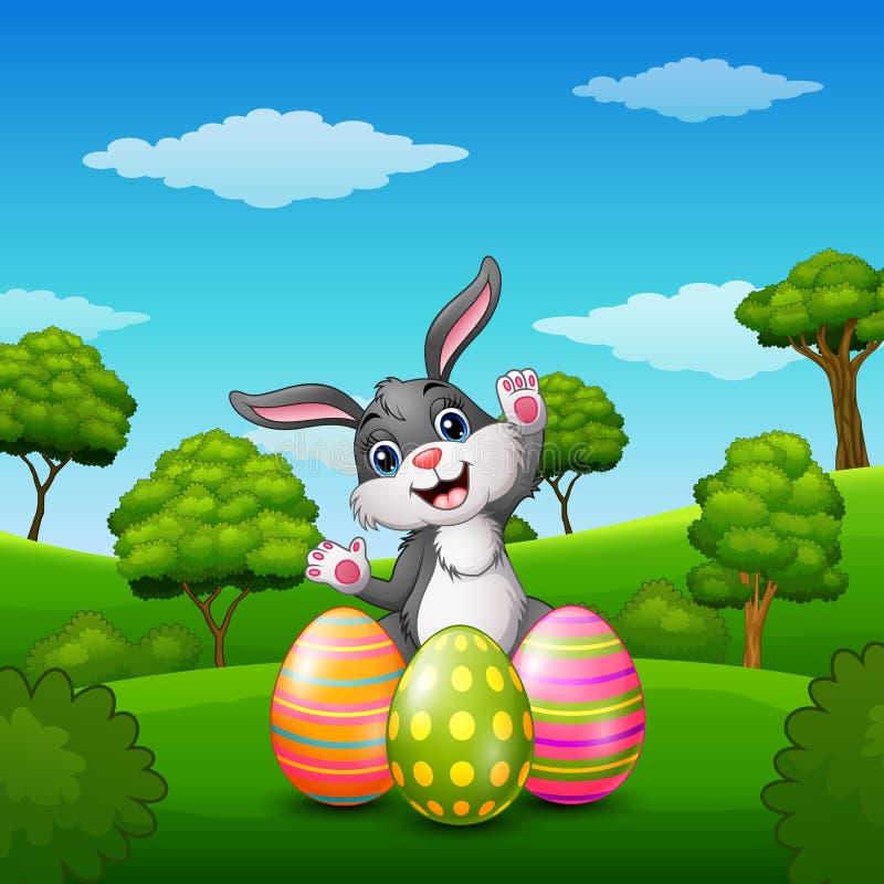 Gelukkig konijnbeeldverhaal met paaseieren in het park stock illustratie