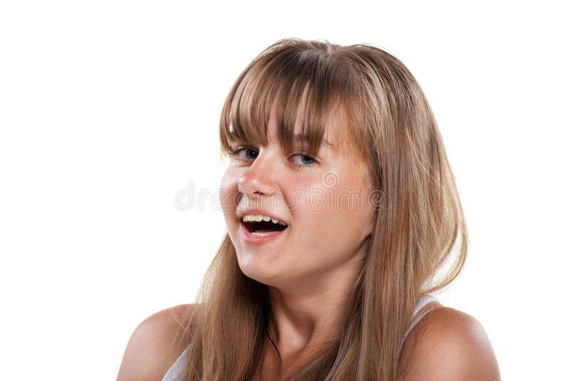 Gelukkig lachend tienermeisje op witte achtergrond royalty-vrije stock afbeelding