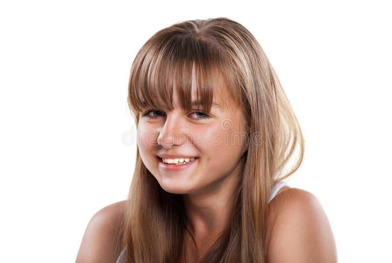 Gelukkig lachend tienermeisje op witte achtergrond stock fotografie