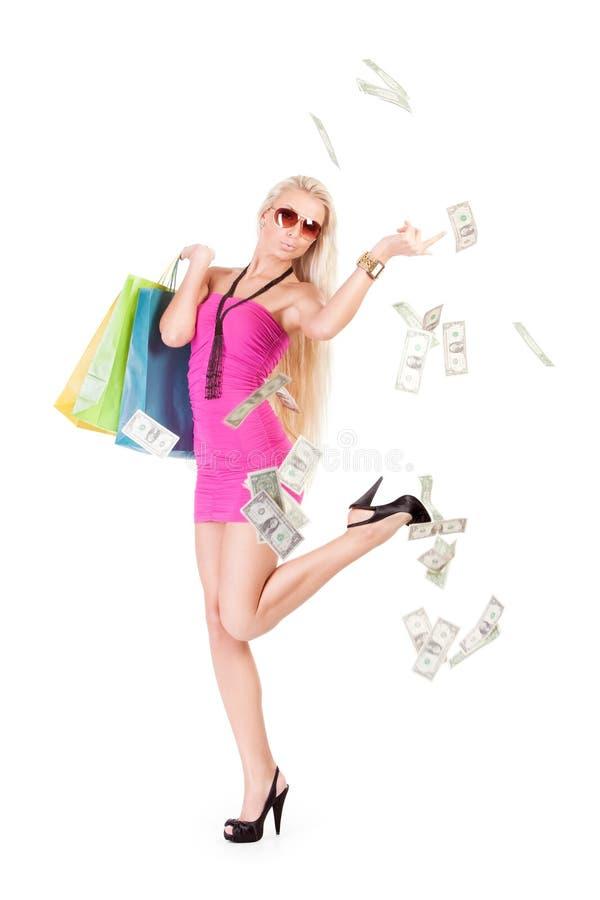 Gelukkig meisje dat geld werpt stock afbeelding