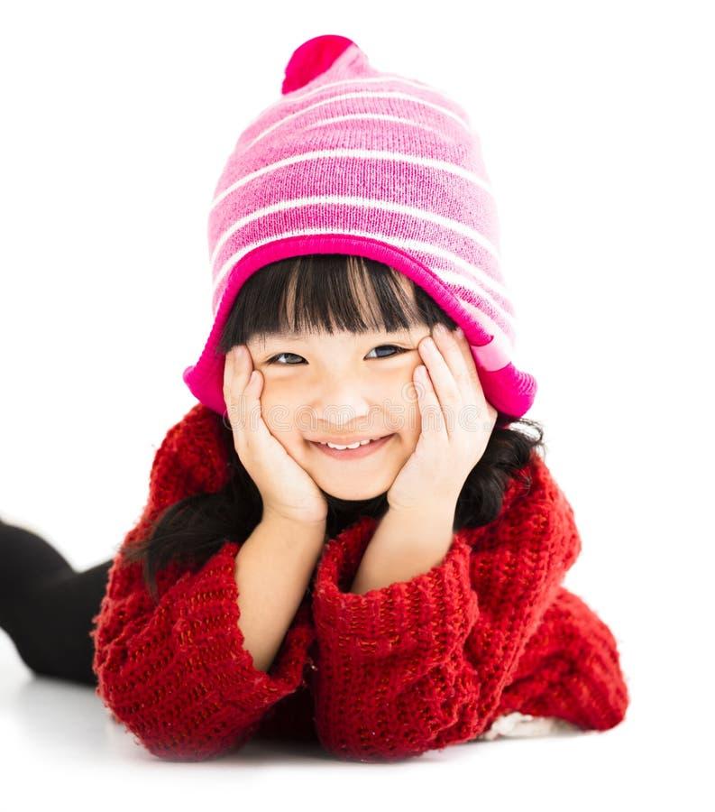Gelukkig meisje in de winterslijtage stock fotografie