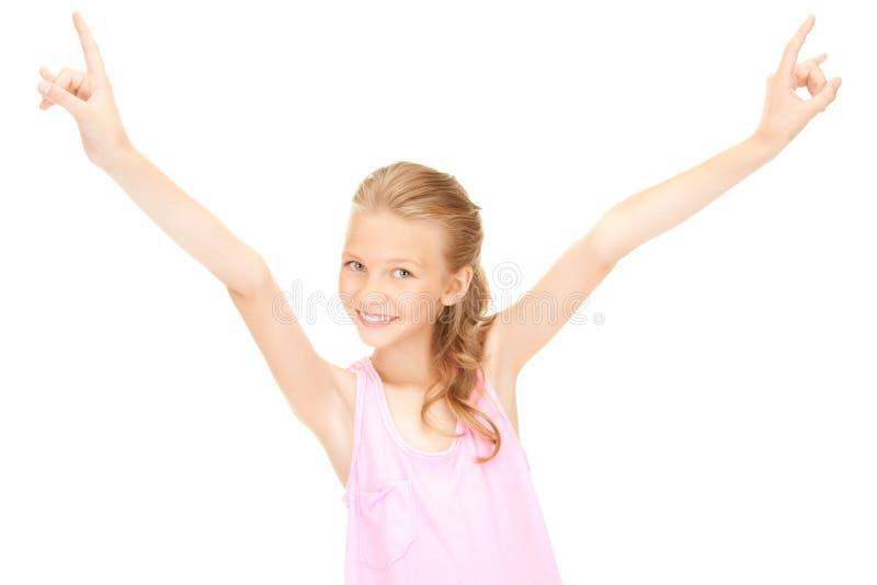 Gelukkig meisje die het gebaar van duivelshoornen tonen royalty-vrije stock fotografie
