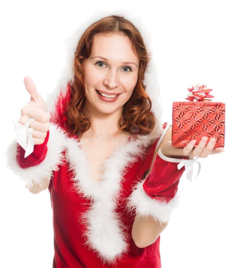 Gelukkig meisje in een kleding die van Kerstmis o.k. teken toont royalty-vrije stock foto's