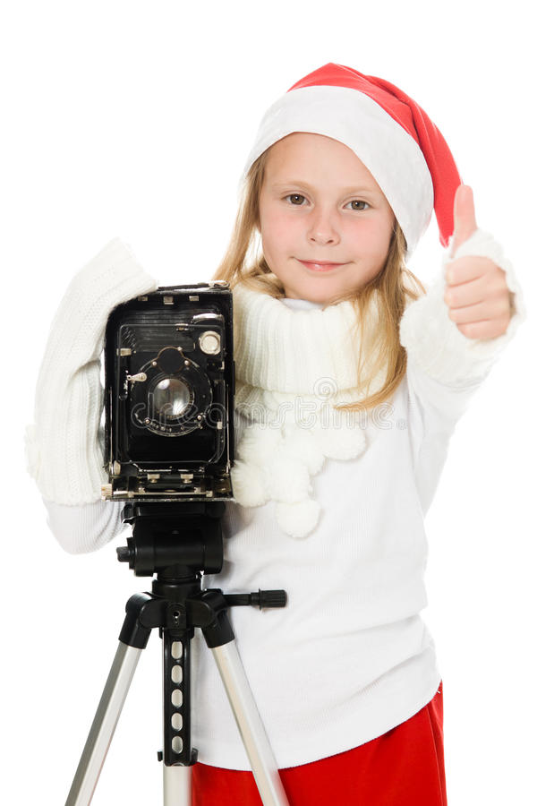Gelukkig meisje in een kostuum van Kerstmis met oude camera royalty-vrije stock afbeeldingen