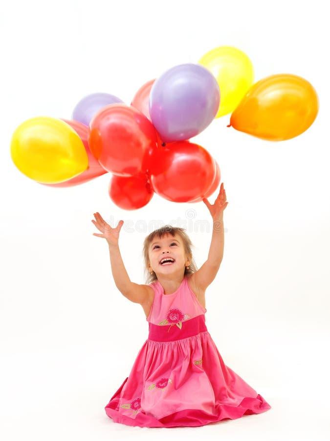 Gelukkig meisje met ballons royalty-vrije stock fotografie