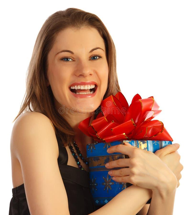 Gelukkig meisje met een gifl. Geïsoleerdu op wit stock foto