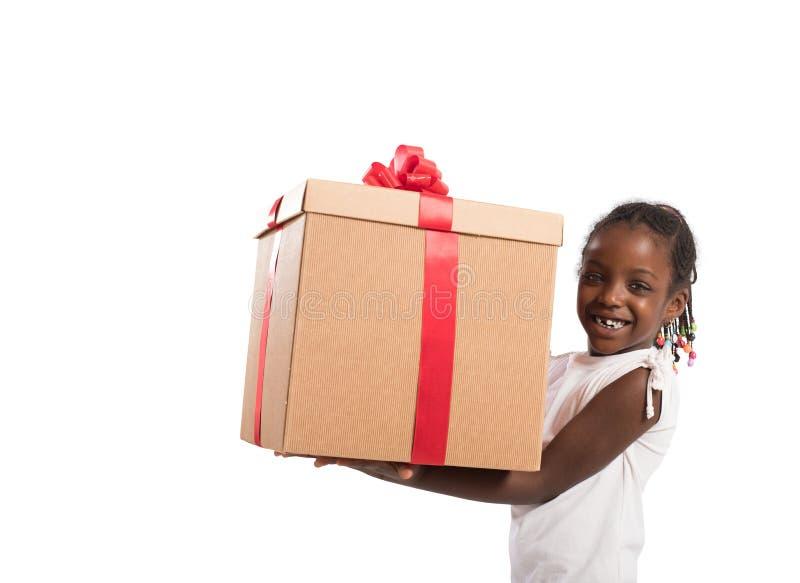 Gelukkig meisje met een gift van Kerstmis royalty-vrije stock foto's