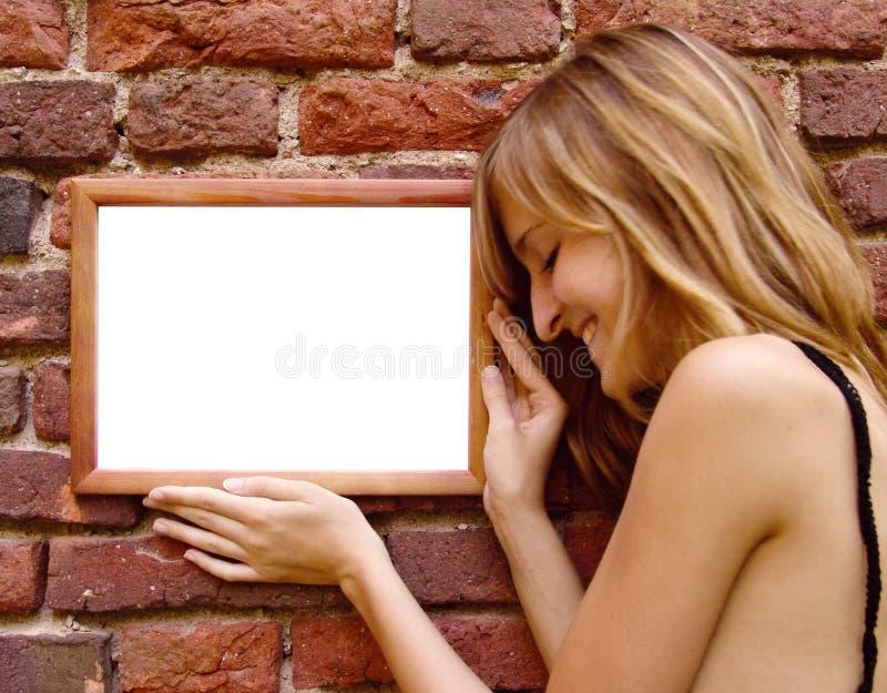 Gelukkig meisje met frame royalty-vrije stock fotografie