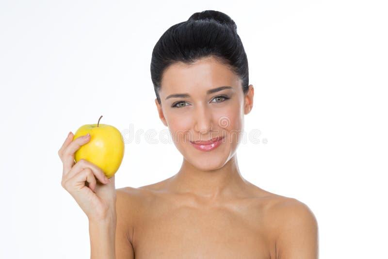 Gelukkig meisje met gele appel stock foto